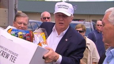Donald Trump and Mike Pence help move supplies at a Baptist church in a heavily damaged portion of East Baton Rouge Parish in Louisiana.