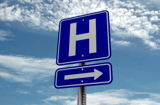 Hospital this way sign