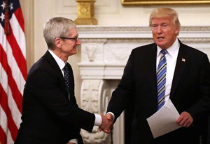 Apple CEO Tim Cook and U.S. President Donald Trump at tech summit in June 2017
