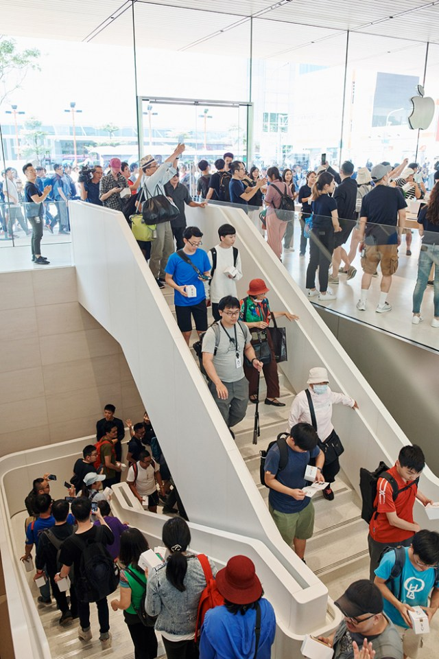 The two-level Apple Xinyi A13 store features all of Apple's latest products for customers to explore.
