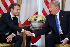 Presidents Trump and Macron shake hands during their meeting at Winfield House, London on Dec. 3. Photographer: Ludovic Marin/AFP via Getty Images