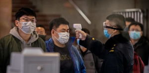 Foxconn restarts China plant. Pictured: People in masks