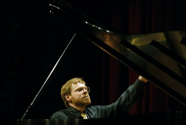 Mr. Hawley at the piano in 2002 in the Van Cliburn amateur piano competition in Fort Worth. He shared first prize. Formally trained, he studied both music and computer science at Yale, earning degrees in each. (Credit: Michael Hawley)