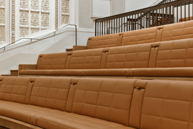The theater's original balcony seating has been modernized and made accessible, creating an open, flexible space for Genius Bar appointments.