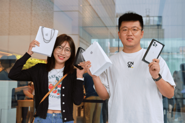Customers at Apple Sanlitun in Beijing, China, explore the newest iPhone and iPad lineups