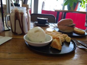 milkshake, icecream, pancakes, burgers on table