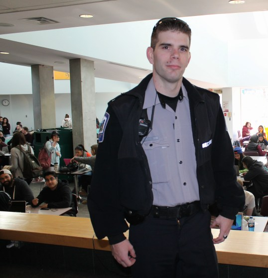 MacEwan University Security Officer James Flood, 25, patrols past the Building 6 cafeteria.