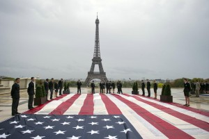 Student officers display a US giant national flag on the Trocadero square with the Eiffel tower in the background during a solemn tribute to the victims of the 9/11 attacks on September 11, 2011 in Paris. Several commemorations are held in France today to mark the 10th anniversary of the 9/11 attacks which killed almost 3,000 people in NYC and Washington and plunged the US into an era of war. AFP PHOTO / FRED DUFOUR (Photo credit should read FRED DUFOUR/AFP/Getty Images)