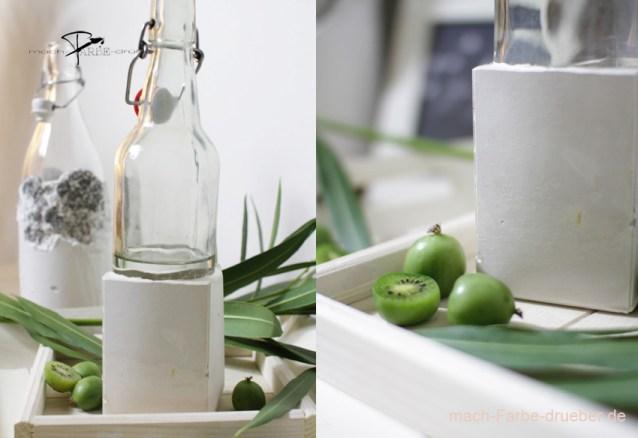 Vasen aus Gips und Glasflaschen