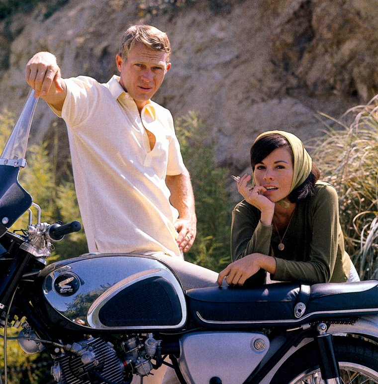 Steve McQueen and Neile Adams with their Honda motorcycle