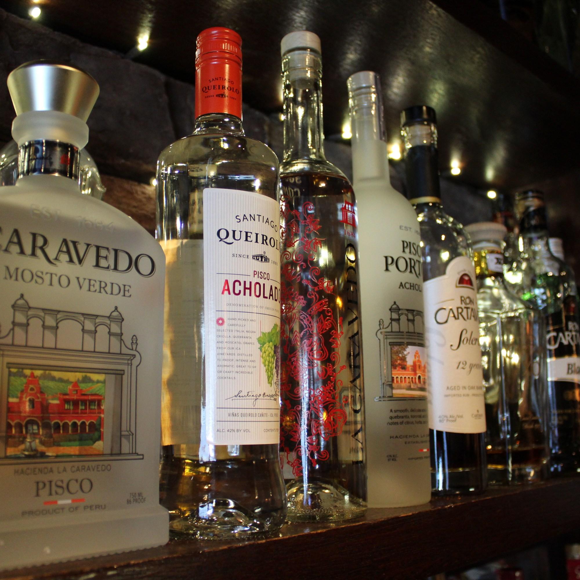 bar bottles on mahogany shelf
