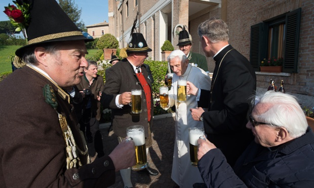 Pope Emeritus Benedict XVI toasts his 88th birthday with his brother Georg Ratzinger, right, Monsignor Georg Gänswein, second from right, and members of a group from his home town in Bavaria. Photograph: L'Osservatore Romano/AP