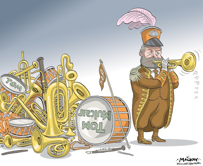 Editorial Cartoon by Graeme MacKay, The Hamilton Spectator Ð Saturday March 19, 2016 Mulcair at risk of ouster by crush of new critics Tom Mulcair doesnÕt come across as the kind of person whoÕd spend much time looking over his shoulder, even if he had to. But these days you have to wonder whether the NDP leader, who celebrates his fourth anniversary as head of the party next week, is taking the time to look both ways before he crosses any political streets between now and his partyÕs convention next month. It would be wrong to say rumblings over MulcairÕs future with the party began only last week. Those rumblings have been a staple of the NDPÕs background noise since its dismal showing in the Oct. 19 election. But with the exception of a well publicized sortie by Ontario NDP MPP Cheri DiNovo in January, and complaints last month from a newly minted Montreal-area riding association president, any I-told-you-sos had been uttered off the record, if only in apparent deference to the panel the party convened to autopsy why things went horribly wrong during the last campaign. Given that the panelÕs findings compelled Mulcair to write a letter of apology to the partyÕs rank and file and take full responsibility for the NDPÕs return to third party status, it wasnÕt entirely surprising to hear the volume turned up last week on the complaints over MulcairÕs leadership. It started when Sid Ryan, former head of the Ontario Federation of Labour, told the Globe and Mail last week that MulcairÕs Òoverbearing personalityÓ made it necessary for the NDP to seek out new leadership. That was followed by letters published in Le Devoir and the Toronto Star this week that didnÕt mention Mulcair by name but may as well have spray painted it in day-glo orange across its text as three defeated MPs and nearly three dozen party activists complained the NDP had come adrift from its ideals and purpose. That missive was quickly followed by a far more specific slam against Mulcair by NDP s