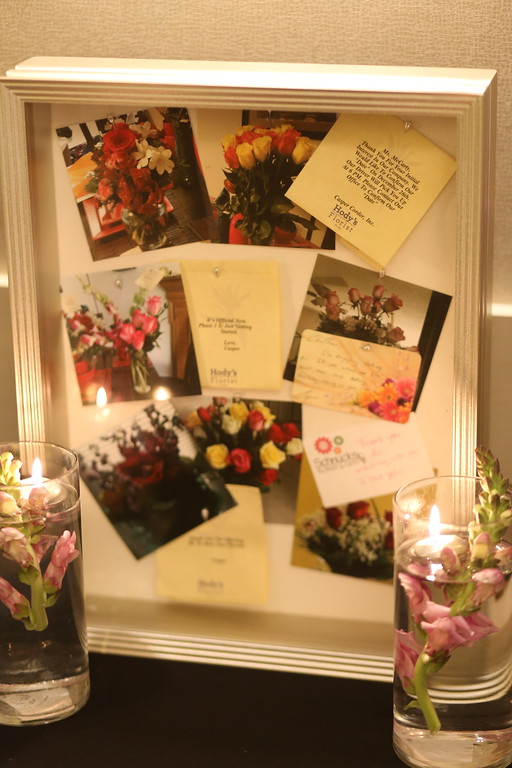 Shadowbox with photos and flower cards from the display table.