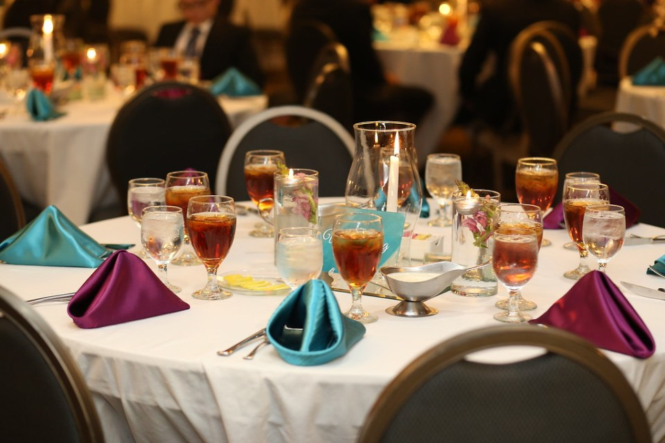 Purple and teal napkins. White tablecloths. Sweet tea.