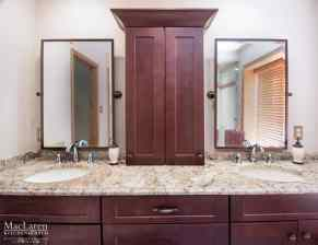 His and Hers Vanity Sink with Furacan Bordeaux Granite countertop and Waypoint Cabinetry