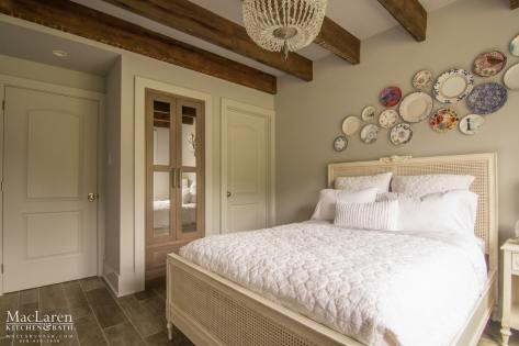 Guest bedroom with custom linen cabinetry