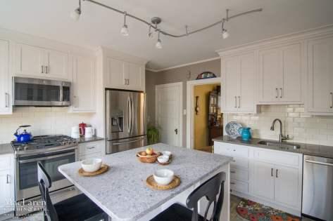 Quartz Kitchen with 3x6 Cracked Ivory Daltile Tile Backsplash