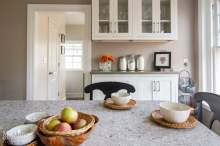 Compact Island Seating Area in Traditional Quartz Kitchen