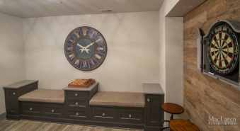 Bench Seating Area and Storage Cabinetry for Basement Game Room