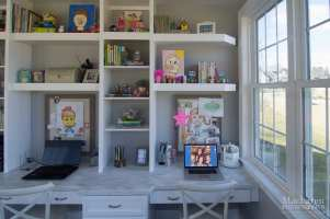 Custom floating shelves to accommodate tall windows