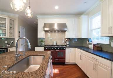 Leathered Angola Black Granite Perimeter and Tropical Brown Granite Island Countertop