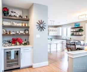 At the entrance of the kitchen, there is a welcoming Butler's Pantry with floating shelves for all your nicknacks.