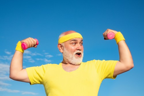 athletic old man and dumbells