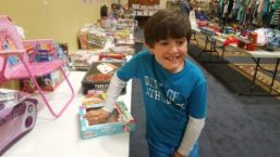 Sam checking out one of the tables of toys at Second Impressions.