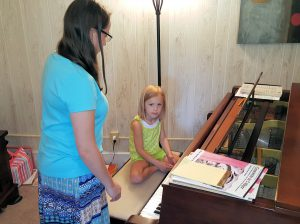 Children as young as four or five begin their music instruction at Greenwood School of Music. Photo by Doug Deal.