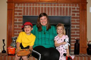 Trick-or-treaters by the fireplace