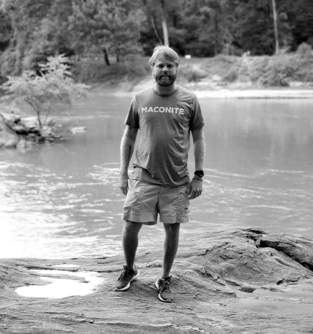 Amerson Rock founder sporting one of their earliest designs, the Maconite t-shirt, on one of the rocks at Amerson Park