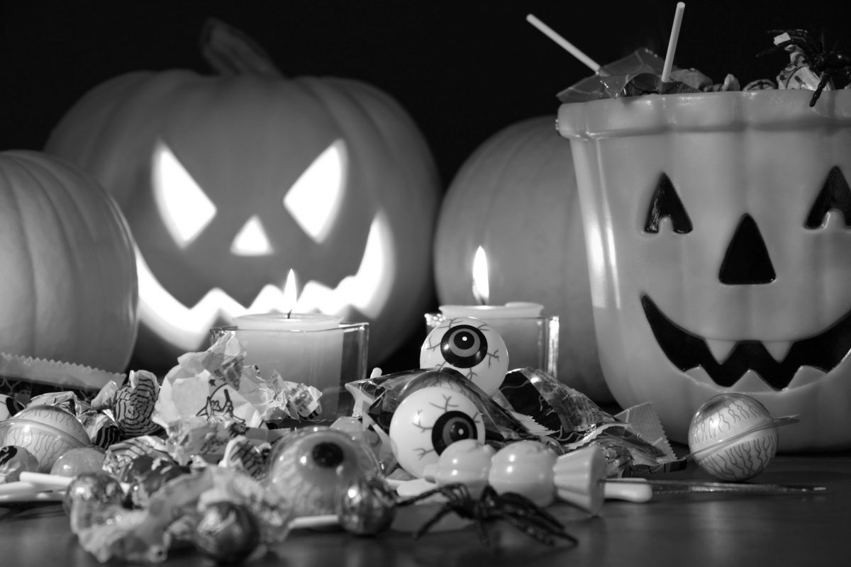 Closeup of candies with pumpkins after Hallowen festivities