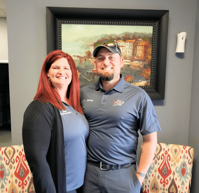Nurse Practitioner Jaimi Norrell and her husband Kevin, in the beautiful lobby of Hands of Grace Free Medical Clinic at Abundant Grace Church. Photo by Lauren Deal.