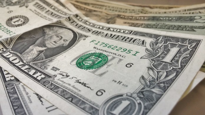 Dollar suffers trade war