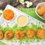 Millet and tofu balls with peanut and mustard dressing