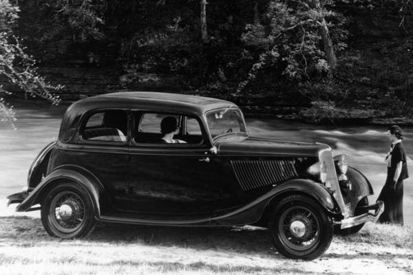 1933 Ford Victoria woman and river