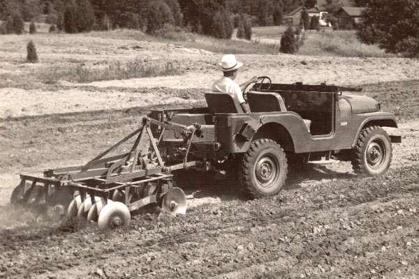 Willys Jeep CJ-5 pulling disc harrow