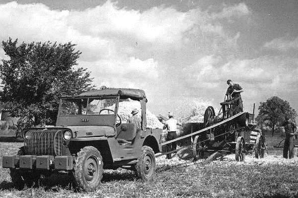 Willys Jeep with power takeoff operating thresher