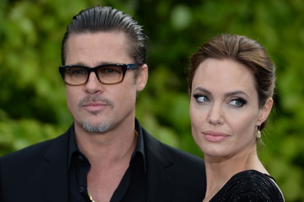 "Angelina Jolie attends the premiere of ""Maleficent"" at Kensington Palace, Kensington, London, UK, on May 8, 2014. Pictured: Angelina Jolie and Brad Pitt Ref: SPL754141  080514   Picture by: James Whatling / Splash News Splash News and Pictures Los Angeles:	310-821-2666 New York:	212-619-2666 London:	870-934-2666 photodesk@splashnews.com"