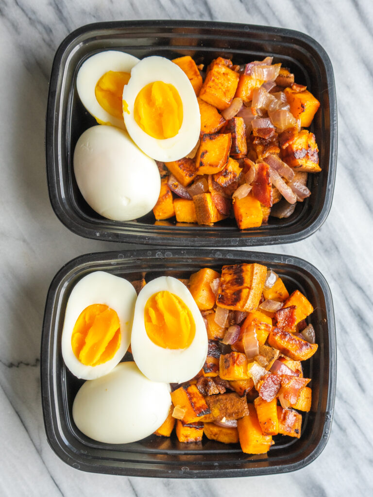 Above view of a paleo breakfast in meal prep conatiners