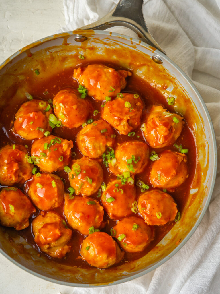 Above view of chicken meatballs in a frying pan