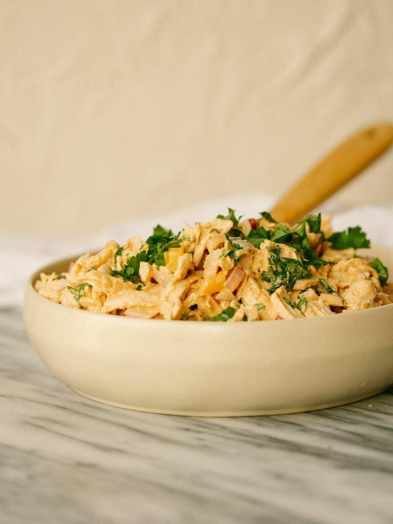 Side view of fajita chicken salad in a serving bowl