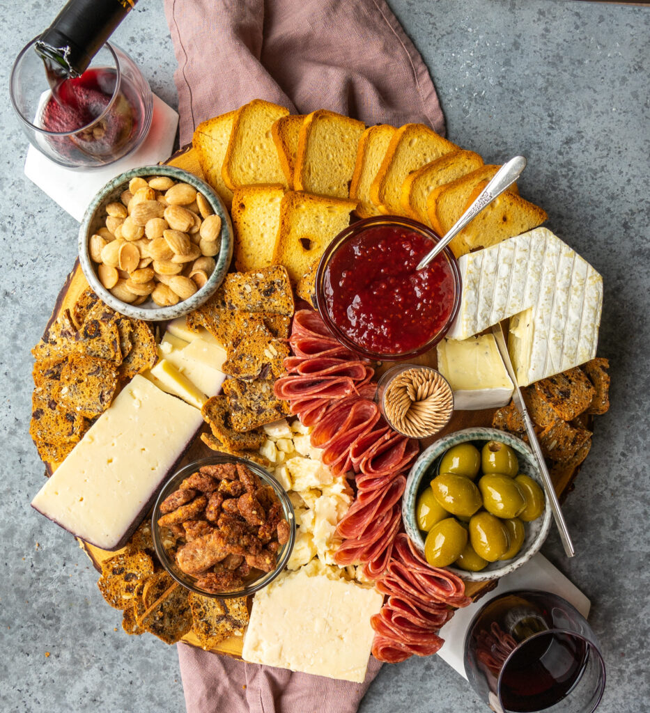 Above view of a trader Joe's charcuterie board with red wine