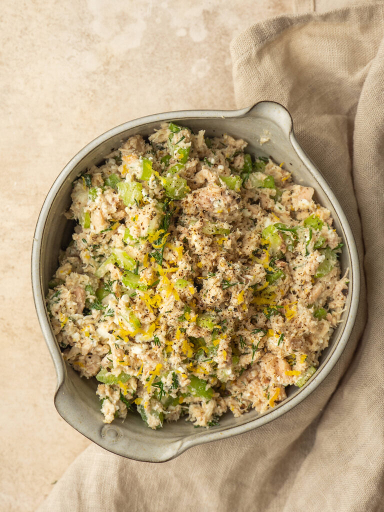 Above view of a refreshing healthy tuna salad made with feta, lemon and fresh dill