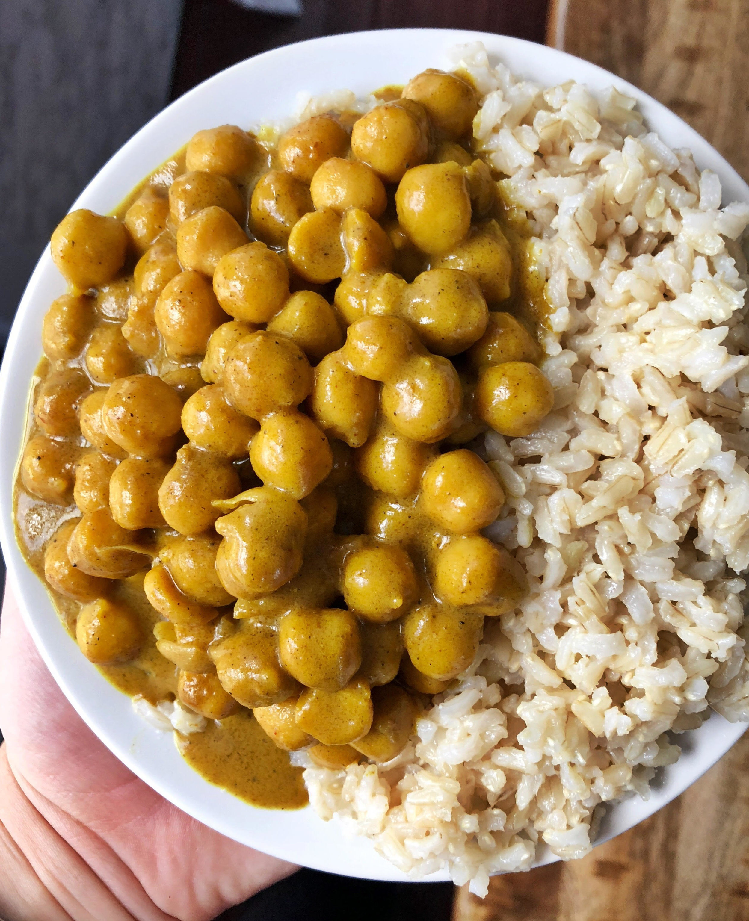 Above view of chickpea pumpkin curry in a bowl with rice