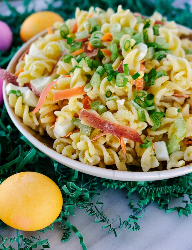 Three quarter view of deviled egg pasta salad in a bowl