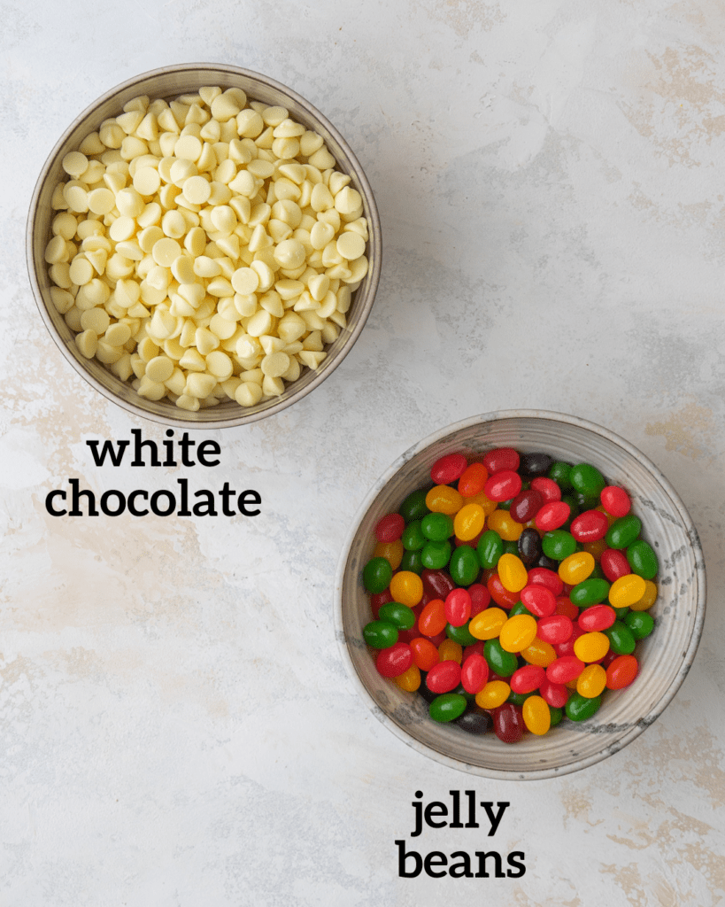 Above view of ingredients for jelly bean bark: White chocolate chips and starburst jelly beans