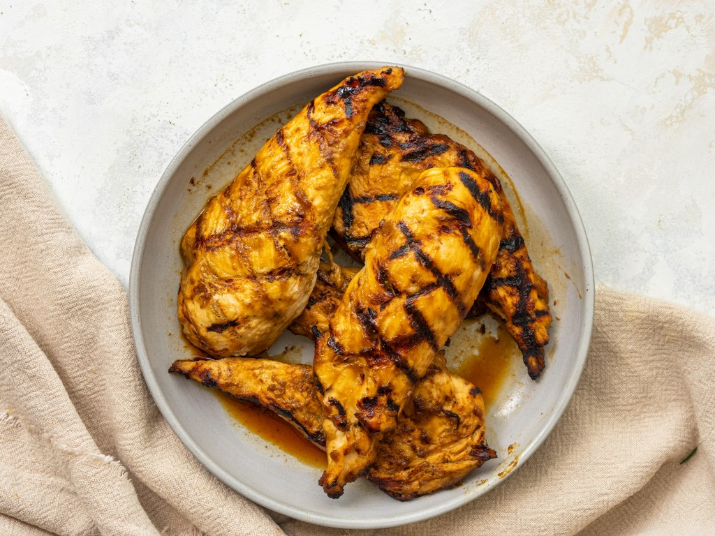Above view of balsamic grilled chicken on a serving plate