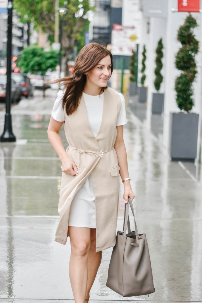 Perfect work outfit for women. Woman wearing a white shift dress with a structured vest and heels for a day at the office! SPRING LAYERING OUTFIT: STYLED 3 WAYS